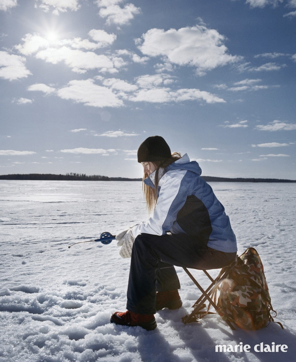 A woman ice fishing