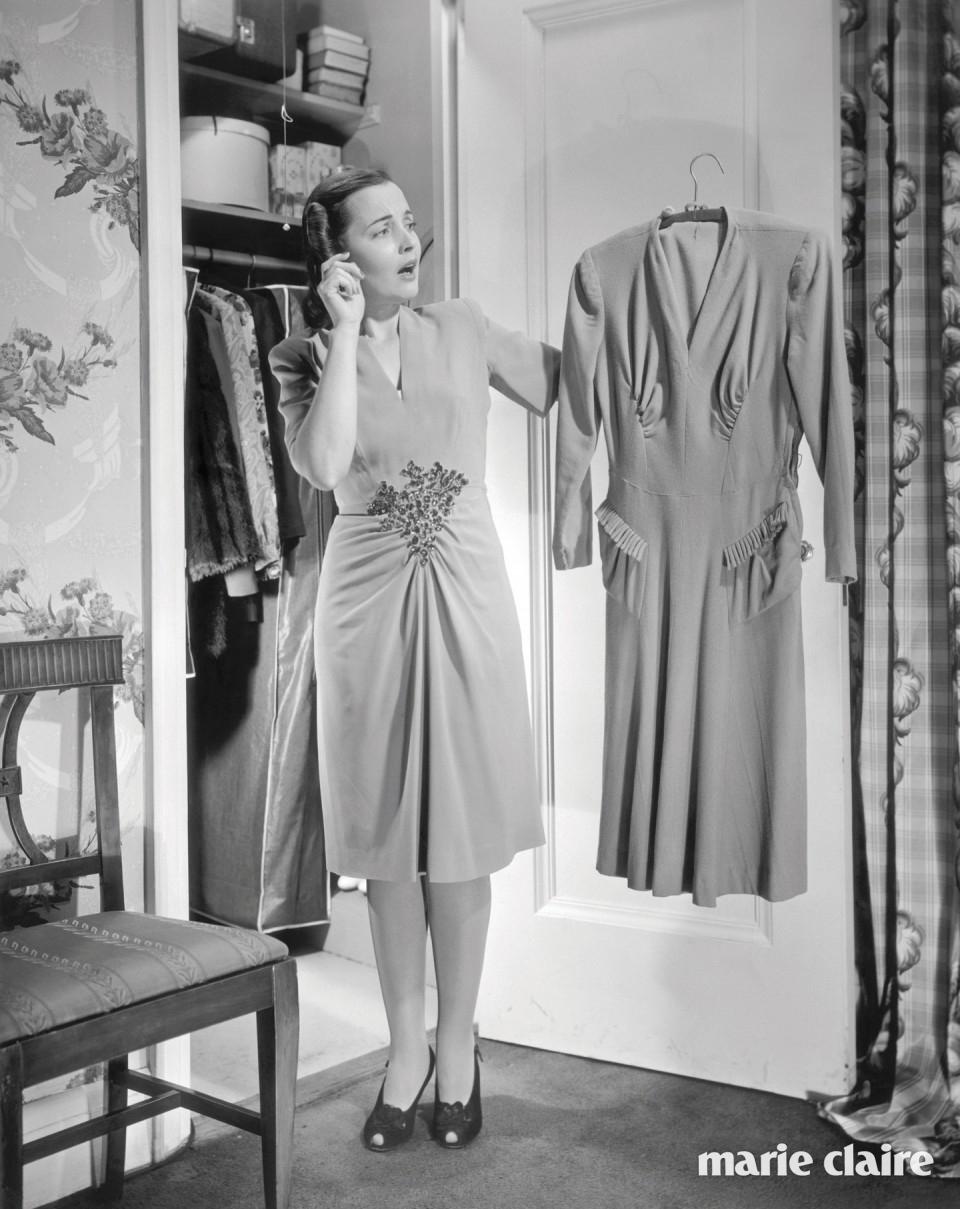 Woman choosing dress from closet