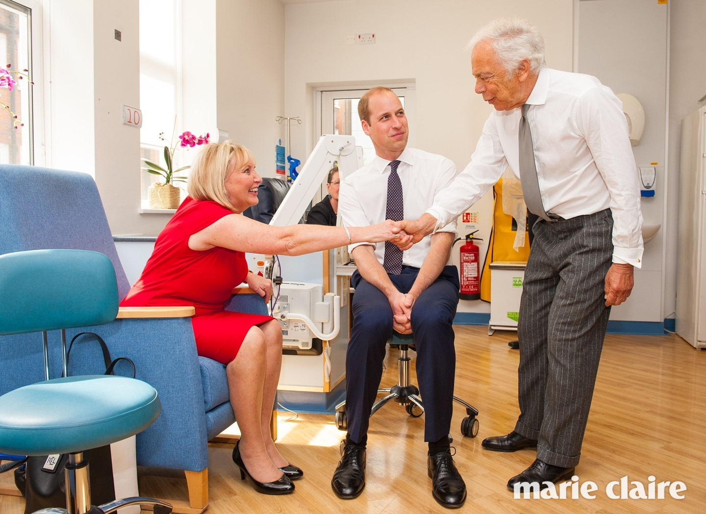 The Duke of Cambridge (centre) and Ralph Lauren (right) meet breast cancer patient Kathryn England during a visit to the Royal Marsden NHS Foundation Trust, in Chelsea, west London, as he marks the opening of the hospital's new centre for breast cancer research named after the fashion designer.