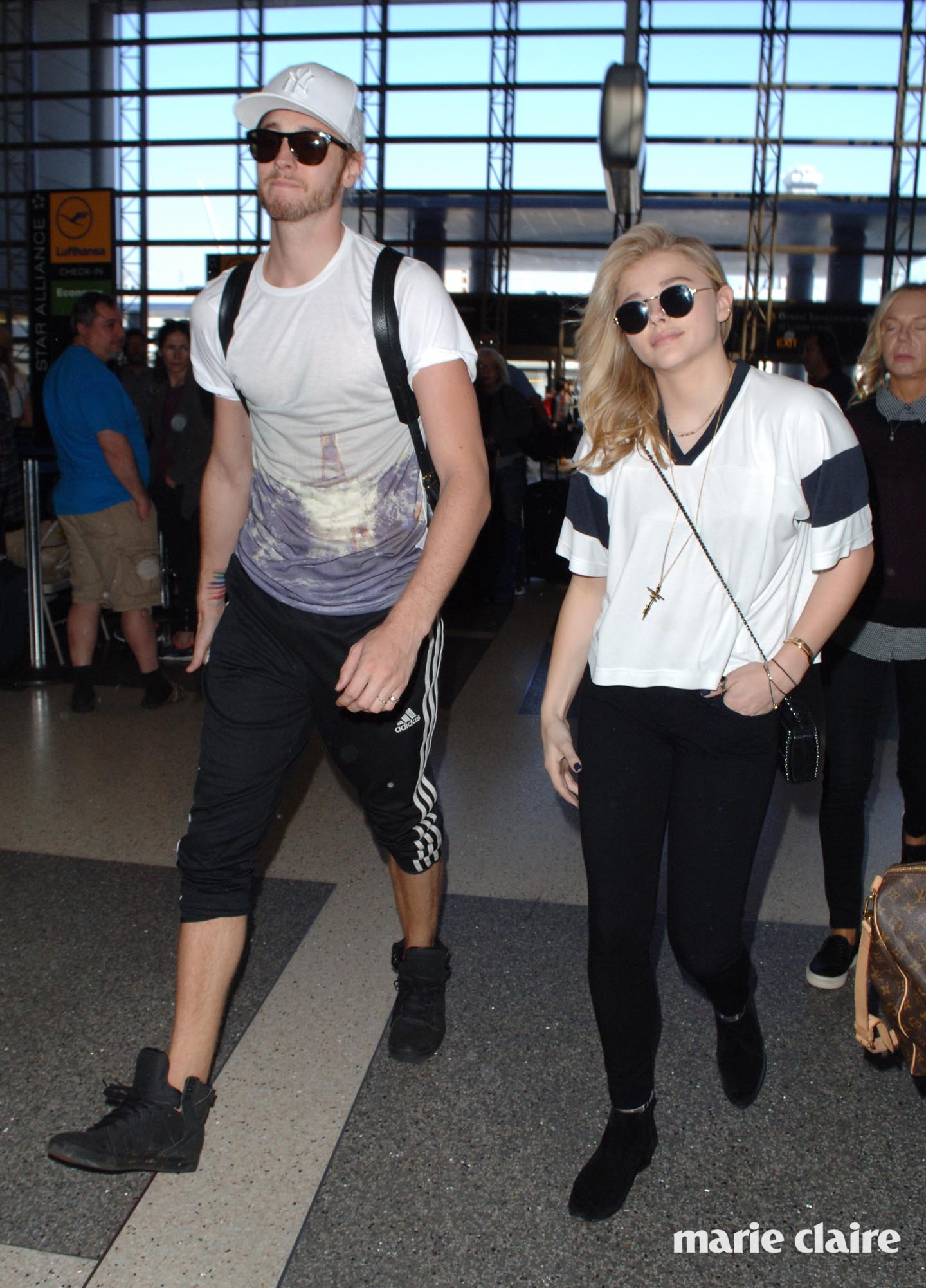 Chloe Moretz departs from Los Angeles International Airport (LAX) with her 6 ft 4. brother, Trevor Featuring: Chloe Grace Moretz, Trevor Moretz Where: Los Angeles, California, United States When: 09 Mar 2015 Credit: MONEY$HOT/WENN.com