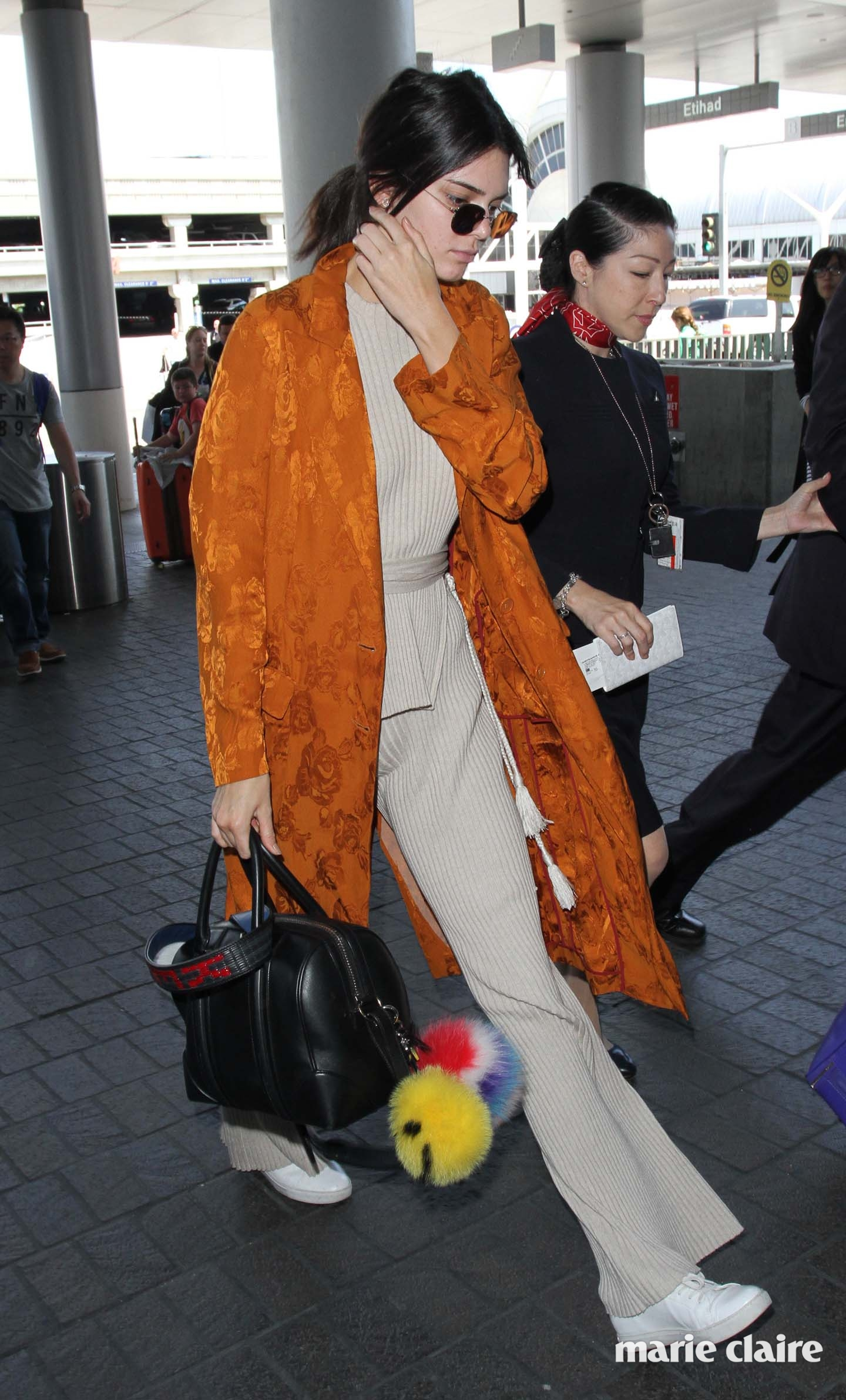 Kendall Jenner makes a striking appearance in an orange coat while catching her flight out of Los Angeles International Airport Featuring: Kendall Jenner Where: Los Angeles, California, United States When: 10 May 2016 Credit: WENN.com