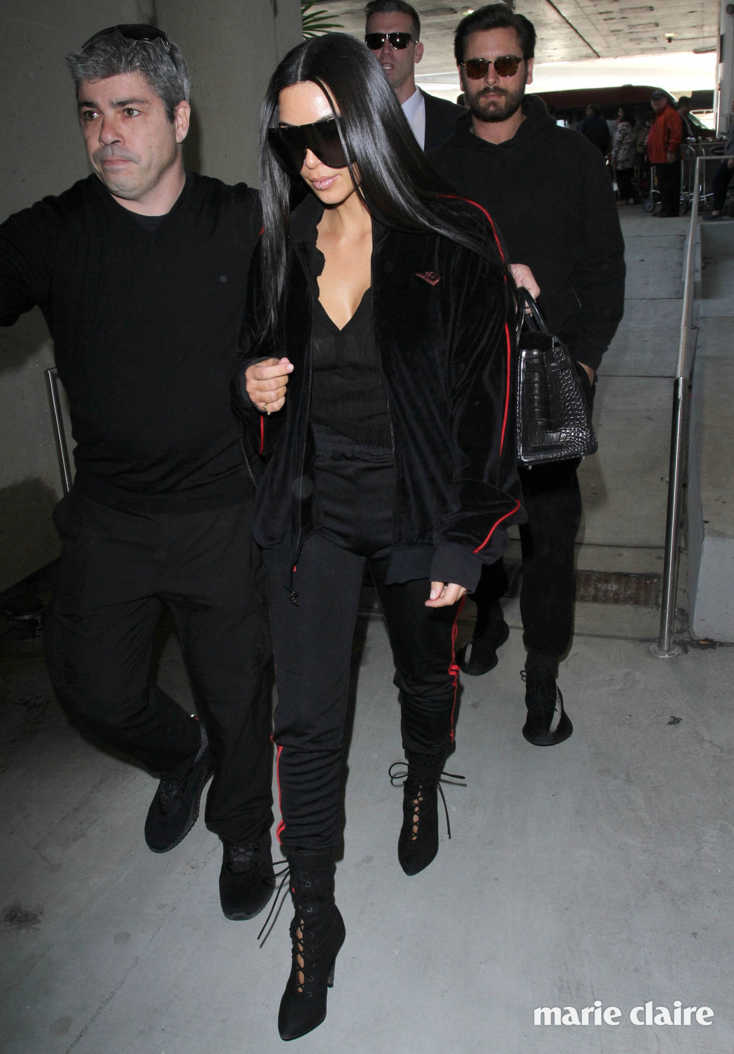 Kim Kardashian sports a lip ring as she and Scott Disick arrive at Los Angeles International (LAX) Airport to catch a flight to Dubai Featuring: Kim Kardashian, Scott Disick Where: Los Angeles, California, United States When: 11 Jan 2017 Credit: WENN.com