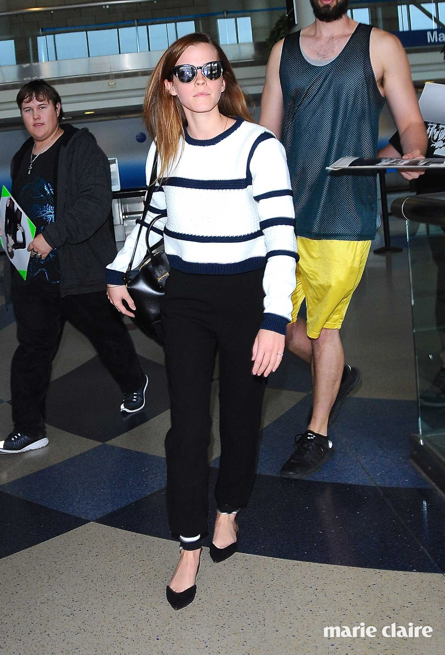 Emma Watson arrives at Los Angeles International Airport (LAX) in flat pointed shoes and stripe top Featuring: Emma Watson Where: Los Angeles, California, United States When: 22 Apr 2015 Credit: WENN.com