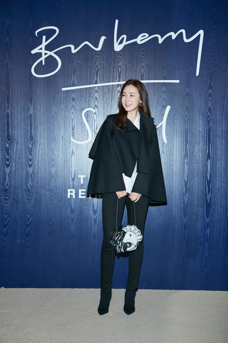 Ji Woo Choi wearing Burberry to an event to celebrate the opening of `The Cape Reimagined' in Seoul