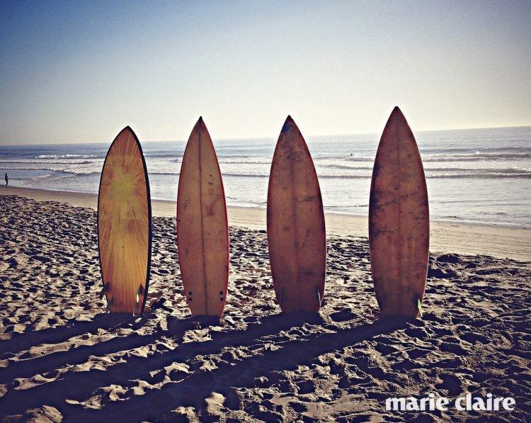 USA, California, Playa del Rey, Surfboards on sandy beach